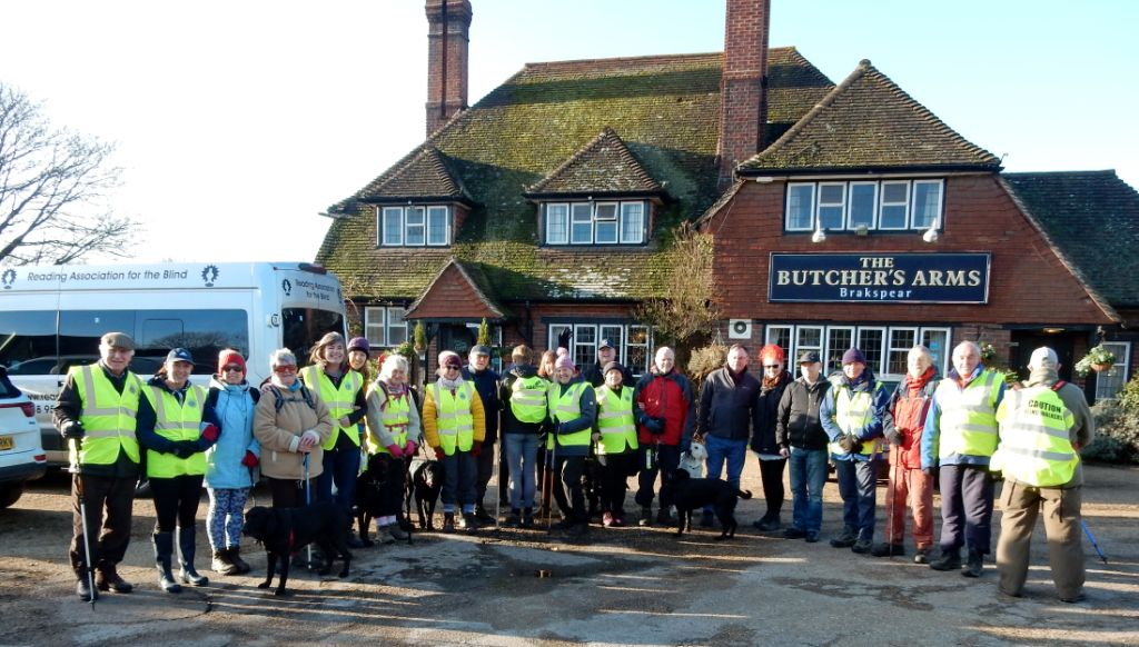 Ramblers and volunteers in front of the Butchers Arms wearing Hi-Vis Jackets