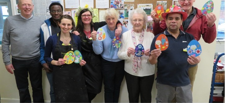 A group of RAB volunteers holding easter eggs made by service users