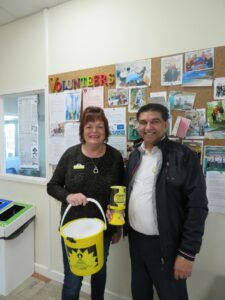Marion and volunteer with collection buckets