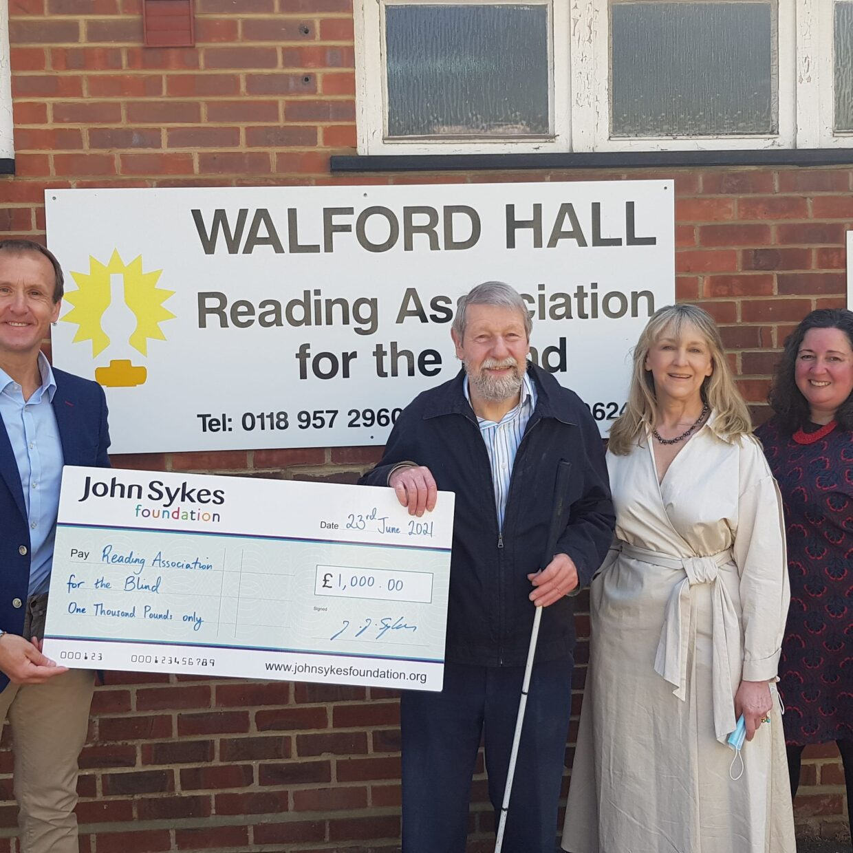 John Sykes presenting a cheque for £1000 to Bob Bristow and Karen Rowland, Trustees, and Adele Barnett-Ward, CEO
